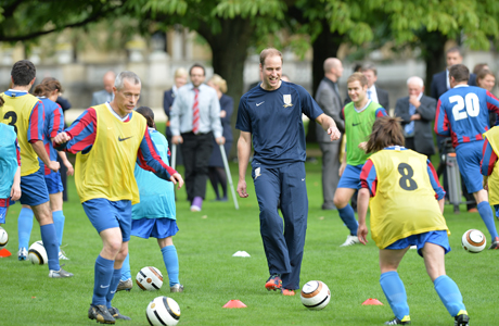 "Prince William hosts a soccer match in his Grandmum's ""backyard"" ... at Buckingham Palace. (AP)"