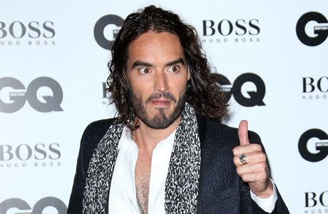 Russell Brand arrives at GQ Men of the Year Awards in London. (Photo by Joel Ryan/Invision/AP Images)