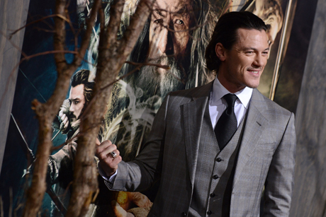 Luke Evans (Bard the Bowman) seems to be keen on the poster ... waidaminute, is that his character he's pointing at! (Jordan Strauss/Invision/AP)