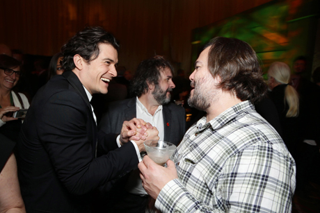 "As the night progresses, Bloom ""lets his hair down"" engaging with Jack Black. Jackson is in the background but distracted. (Eric Charbonneau/Invision for Warner Bros./AP Images)"