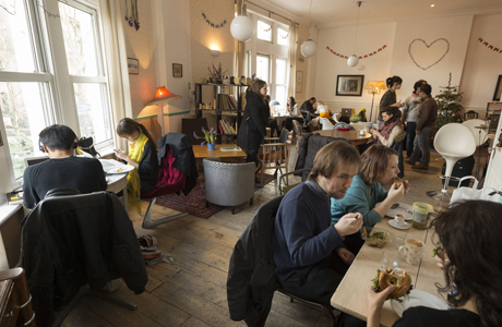 Guests enjoy the communal room at this pay-as-you-go cafe.  (Rex Features via AP Images)