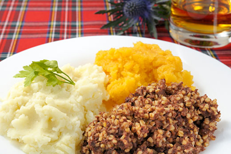 Haggis is a meat and oatmeal mixture cooked in a casing. It might be served with sides like mashed potatoes. (XX)