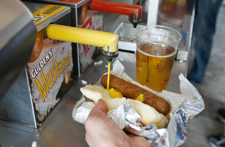 Why does a hot dog smell and taste better when outside at a baseball stadium? (AP Photo/Scott Boehm)