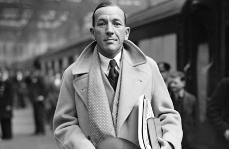British actor, composer and playwright Noel Coward arrives at Waterloo train station in London, England, in 1937.  (AP Photo)
