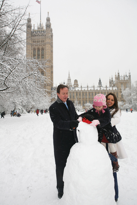 Winter weather.Conservative leader David Cameron and Carol Vorderman help a child build a snowman in Victoria Tower Gardens near the Houses of Parliament in central London. David Cameron is unveiling a package of proposals aimed at improving numeracy, including a maths task force headed by former Countdown host Carol Vorderman. See PA story EDUCATION Maths. Picture date: Monday February 2, 2009. See PA story Photo credit should read: Katie Collins/PA Wire URN:6832277 (Press Association via AP Images)