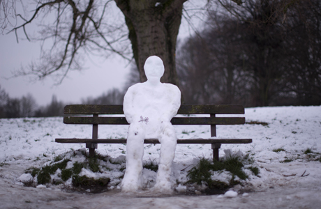 A snowman sits on a bench on Hampstead Heath in London, Tuesday, Jan. 22, 2013. Britain has been in the grip of cold snowy weather since the weekend . (AP Photo/Matt Dunham)