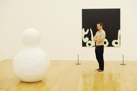 Caulfield and Hume at Tate Britain. A visitor looks at 'Back of a Snowman(White) 2000' by artist Gary Hume during the press view for Patrick Caulfield and Gary Hume at Tate Britain, Linbury Galleries, London, which opens to the public from 5 June - 1 September. Picture date: Monday June 3, 2013. Photo credit should read: Nick Ansell/PA Wire URN:16699895