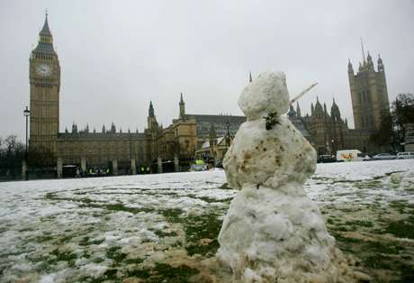 A snowman stands near the Palace of Westminster, after snowfall in central London, Thursday Feb. 8, 2007. Five British airports were closed and train services disrupted after heavy snow fell in England and Wales. (AP Photo/Matt Dunham)