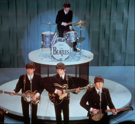 The Beatles make their first appearance on The Ed Sullivan Show on February 9. (AP Photo)