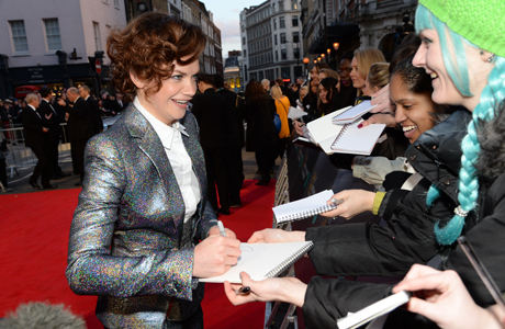 Ruth Wilson signs autographs on the red carpet at the EE British Academy Film Awards in London. (Photo: Rex Features via AP Images)