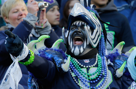 No, Brits, you don't need the full regalia and facepaint like this particularly enthusiastic Seattle Seahawks follower. But there are a few differences between fandoms in America and Britain. (Photo: (AP/John Froschauer)