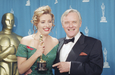 "Sir Anthony Hopkins points to the Oscar that Emma Thompson is holding for her win as Best Actress for her work in ""Howards End"" at the 65th Annual Academy Awards in Los Angeles Monday, March 30, 1993.  (AP Photo/Douglas C. Pizac)"