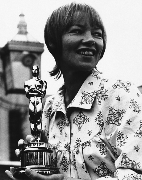 British actress Glenda Jackson holds her Oscar award which she won for her performance in the film ?women is love? after she presented with it in April 1971 in London by Hal B. Wallis, a member of the board of governors of the motion picture academy of arts and sciences. (AP Photo/Robert Dear)