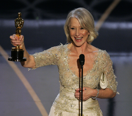 "British actress Helen Mirren accepts the Oscar for best actress for her work in ""The Queen"" the 79th Academy Awards Sunday, Feb. 25, 2007, in Los Angeles. (AP Photo/Mark J. Terrill)"