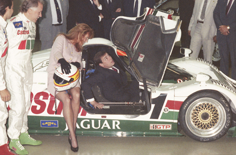 Britainís Duke and Duchess of York take an inside look at one of the Castrol Jaguar Racing Teamís cars while attending the grand opening of the $25 million dollar North American headquarters of Jaguar Cars Inc. in Mahwah, New Jersey on June 5, 1990. (AP Photo/Malcolm Clarke)