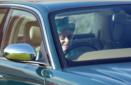 Britain's HRH Queen Elizabeth, perpares to drive away in her Jaguar from Guards Polo Club in Windsor Great Park, Sunday, July 24, 2005. (AP Photo/Sergio Dionisio)