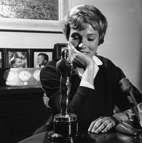 Julie Andrews is seen admiring the Oscar she won for Mary Poppins in 1965. (AP Photo)