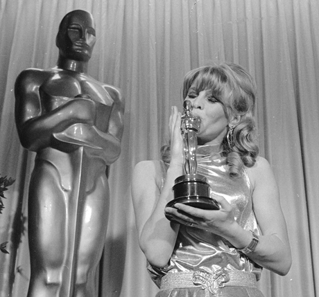 "British actress Julie Christie kisses the Oscar she won as best actress for her role as the man-hungry model in ""Darling,"" April 19, 1966, in Santa Monica.  (AP Photo)"