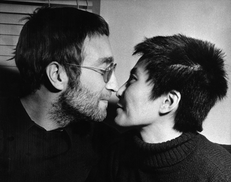 John Lennon and his wife Yoko Ono share an Eskimo kiss (rubbing noses) during an interview in London, Feb. 9, 1970.  Both had their hair shorn in Denmark to be auctioned off in London.  The proceeds will go to the Black Power organization in Britain.  (AP Photo/Bob Dear)