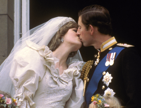 FILE - In this July 29, 1981 file photo, Britain's Prince Charles kisses his bride, Princess Diana, on the balcony of Buckingham Palace in London, after their wedding.  Prince Charles is readying the paperwork to claim his pension when he turns 65 on Thursday, Nov. 14, 2013, but he still hasn't started the job he was born to do.  (AP Photo, Pool, File)
