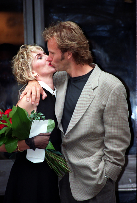 British musician Sting kisses his bride, actress Trudie Styler, after a civil ceremony at Camden Town Hall in London, England Thursday, Aug. 20, 1992. Sting and Styler, who have three children, wed after being together for more than ten years. It is Sting's second marriage, Styler's first.  (AP Photo/Denis Paquin)