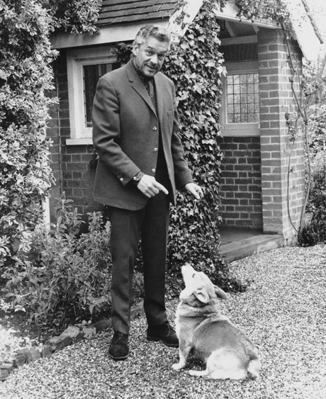 British actor Paul Scofield poses with dog in the yard of his home at Balcombe, England on April 11, 1967. Scofield has just won an Oscar for his portrayal of Sir Thomas more in ?A man for all seasons.? (AP Photo) 1966. A Man for All Seasons