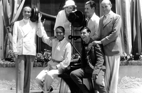Actors, from left to right, Al Jolson, Douglas Fairbanks, Eddie Cantor, Ronald Colman (behind Cantor) and producer Samuel Goldwyn, use this unique telephone in front of Mary Pickford's bungalow at a Hollywood studio on Aug. 23, 1932 to announce the making of a new motion picture.  Miss Pickford is by the mouthpiece.  (AP Photo) 1947. A Double Life
