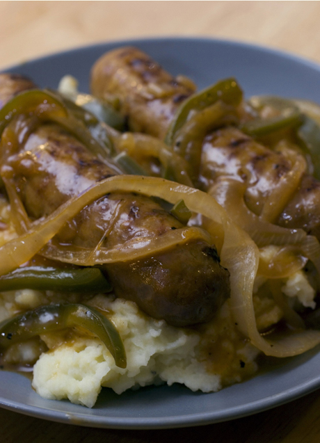"Bangers and Mash is a clever way to describe sausage and mashed potatoes. ""Bangers"" comes from the sound sausages would make when first ... (AP Photo/Larry Crowe)"
