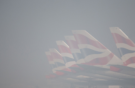 "Spring weather March 13th. British Airways planes on the apron at Heathrow Airport, as number of flights across the UK have been cancelled because of early-morning fog. Picture date: Thursday March 13, 2014. Heathrow airport reported ""minor delays"" on a ""few"" in-bound flights, but said there were no cancellations or delays to flights from the airport. Arrivals and departures were cancelled at London City Airport where forecasters said visibility was down to below 100 metres. Flights have also reportedly been cancelled at Heathrow, Gatwick and Manchester airports. See PA story TRANSPORT Fog. Photo credit should read: Steve Parsons/PA Wire URN:19283240"