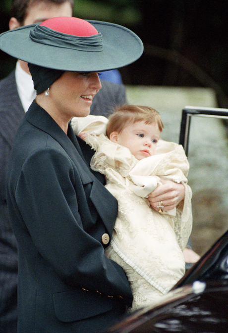 Britain's Duchess of York, Sarah Ferguson, with daughter Eugenie Victoria Helena, who was christened at the Church of St. Mary Magdelen, Sandringham, England, Dec. 23, 1990. Nine month-old Princess Eugenie is the first member of the Royal family to baptized at a public service. (AP Photo/Bill Allen)