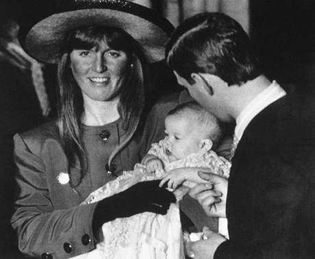 Britainís Duchess of York, Sarah Ferguson, left, holds her daughter, Princess Beatrice Elizabeth Mary, after her christening in the Chapel Royal at Londonís St. Jamesís Palace, Dec. 20, 1988, as the Duke of York gets a closer look at the baby as he holds her hand. (AP Photo/Press Association/Martin Cleaver)