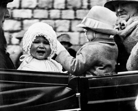Little Princess Elizabeth, left, is shown in 1927. The picture was made as the baby princess was taken for a ride in the grounds of Windsor Castle, she is seen with her cousin, the honourable Gerald Lascelles, right, son of Princess Royal.  (AP Photo)