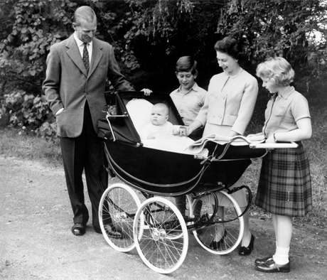 Surrounded by members of the Royal Family, Prince Andrew sits up and takes an interest in the proceedinghs from the comfort of his pram, in the Balmoral Estate. (Press Association via AP Images)