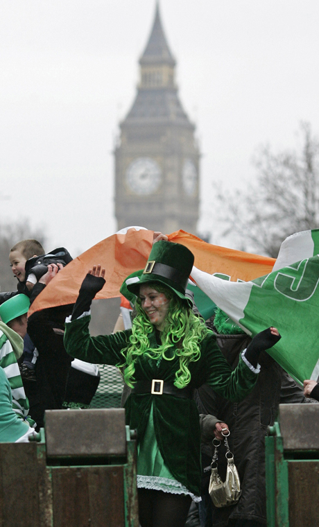 Revellers dance on a float as it parades through central London during the St Patrick's Day parade celebration, Sunday, March 16, 2008. (AP Photo/Sang Tan)
