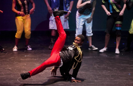 "Choreographer Brandon Couloute break dances during the curtain call at the end of Breakdancing Shakespeare's performance of ""The Tempest"".(Tumblr)"