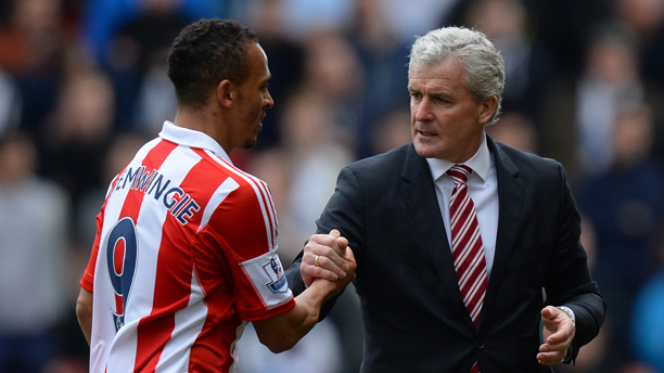 April 12, 2014 - Stoke On Trent, United Kingdom - Mark Hughes manager of Stoke City subs Peter Odemiwingie of Stoke City - Barclays Premier League - Stoke City v Newcastle Utd - Britannia Stadium - Stoke - England - 12th April 2014 - Pic Simon Bellis/Sportimage. (Cal Sport Media via AP Images)