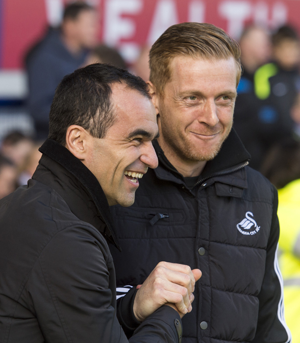 Strictly Editorial Use Only - No Merchandising. For Football Images - Editorial use only. No merchandising. Football Association and Premier League restrictions apply inc. no internet/mobile usage without FAPL license. It is the picture user's responsibility to adhere to all restrictions - for details contact Football Dataco.Everton's Manager Roberto Martinez greets new Swansea manager Gary Monk who played alongside him at Swansea The FA Cup 2013/14, Fifth Round, Everton v Swansea City, Goodison Park (Liverpool, GB) - 16 Feb 2014  (Rex Features via AP Images)