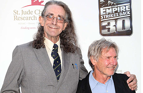 Peter Mayhew as a naked Chewbacca (in a suit) alongside Harrison Ford (Sipa via AP Images)