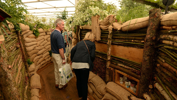 Members of the public walk through a mocked up trench in Birmingham City Council's World War One themed garden at the Royal Hospital in Chelsea, London. Picture date: Tuesday May 20, 2014. Photo credit should read: Andrew Matthews/PA Wire URN:19878888