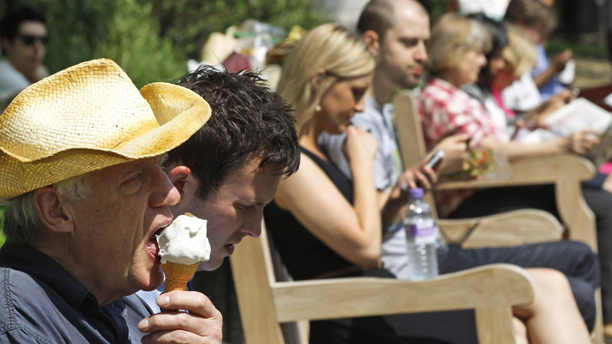 People enjoy the weather during lunch time at a park in central London, Thursday, May 24, 2012. The UK basked in the hottest day of the year as temperatures reached almost 28C Thursday.  (AP Photo/Lefteris Pitarakis)