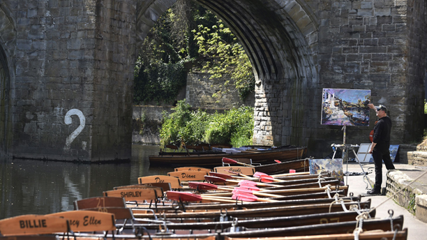 Summer weather May 19th. An artist does some painting in the hot weather in Durham on the banks of the River Wear. Picture date: Monday May 19, 2014. See PA story WEATHER Hot. Photo credit should read: Owen Humphreys/PA Wire URN:19868492