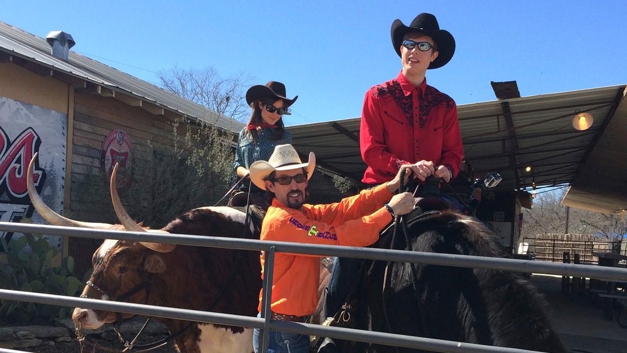 Georgie & Poppy learn to ride longhorn bulls with instruction  from Russell Tiner.
