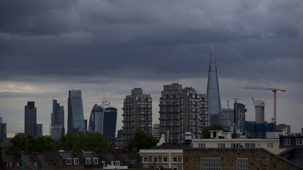 Rain clouds pass over the London skyline including the Shard skyscraper as rain briefly delays play for the second time today during the One Day cricket match between England and Sri Lanka at the Oval cricket ground in London, Thursday, May 22, 2014.  (AP Photo/Matt Dunham)