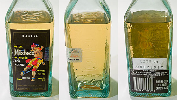 Three bottles of mezcal and one worm. (Pic: Wikipedia)