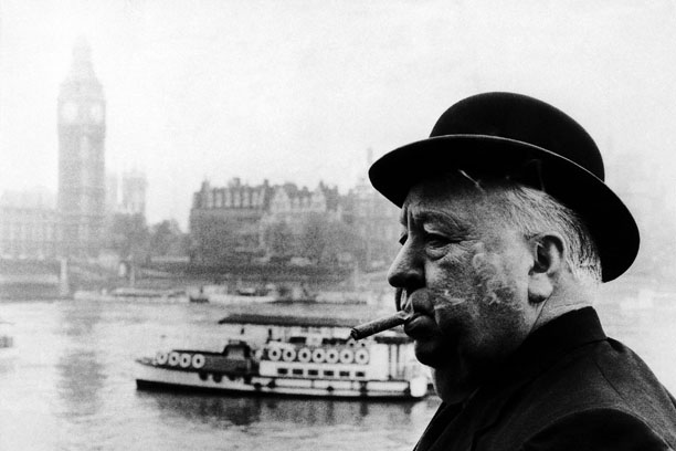 "Nothing says ""London"" quite like this. Alfred Hitchcock takes a contemplative five on the Thames in 1971. (AP Images/HO)"