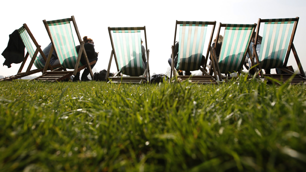 French tourists have a picnic in the park as they sit in the sun in deck chairs in Hyde Park, London, Friday, March, 23, 2012. Temperatures in the capital are expected to rise to 20 celsius (68 fahrenheit) this weekend, far above the normal average for March. (AP Photo/Alastair Grant)
