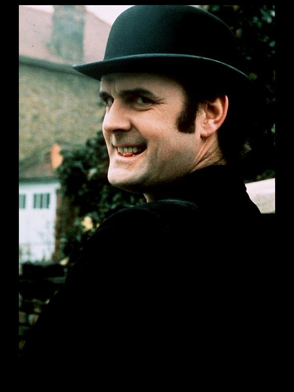 John Cleese rocks the bowler hat to enjoy the bright side of life. (BBC/Python Pictures)