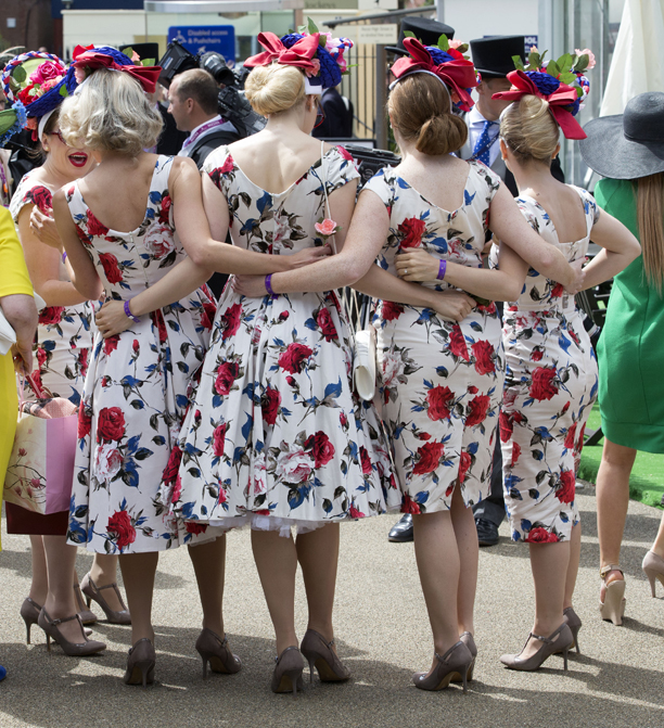 Isn't it just the worst, when someone shows up in the same dress, times three! (Rex Features via AP Images)