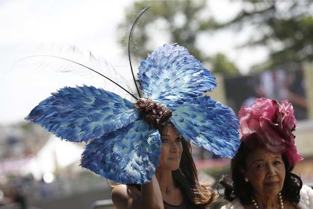 On the other hand, this whimsacle hat just might fly away on its own. (AP Photo/Alastair Grant)