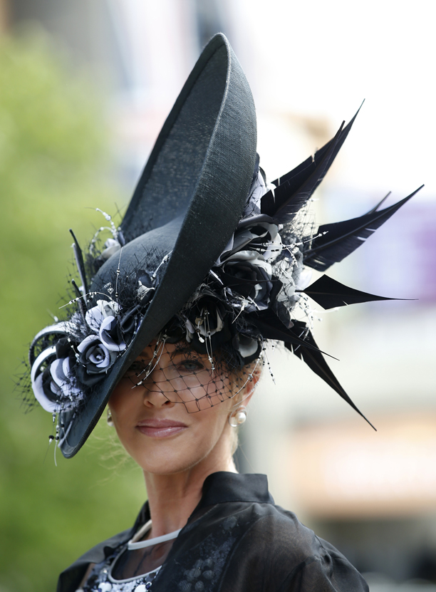 This race horse goer probably doesn't risk seeing her hat coming and going. (AP Photo/Alastair Grant)